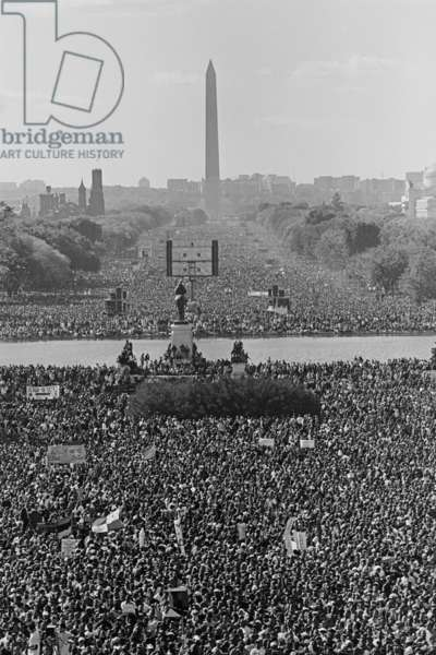 Marchers on the National Mall during the Million Man March, in view towards the Washington Monument. Oct. 16, 1995. Louis Farrakhan, of the Nation of Islam, led the March. Speakers included: Rosa Parks, Dorothy I. Height, James Bevel, Dr. Cornel West, Benjamin Chavis Muhammad