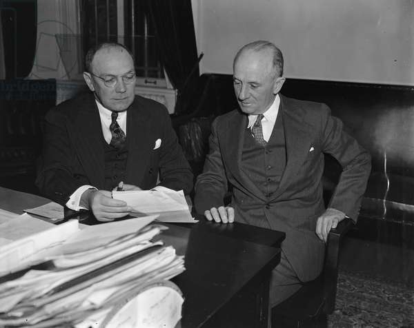 FRANK J. WILSON (1887-1970) Chief of the United States Secret Service and agent in the Treasury Department's Bureau of Internal Revenue (now the Internal Revenue Service), where he was responsible for the prosecution of Al Capone in 1931. Seated at left with Assistant Chief Joseph Murphy, 1 October 1938.