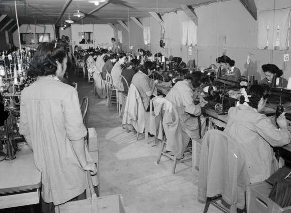 Sumiko Shigematsu, foreman of power sewing machine girls, Manzanar Relocation Center, California, 1943 (b/w photo)