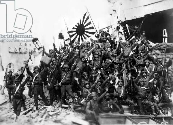 Japan: Soldiers of the Imperial Japanese army, waving the Japanese Naval Standard, celebrate victory at Shanghai, 1937