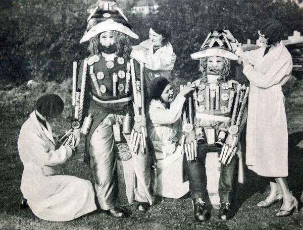 1920's Guy Fawkes Night; preparing a guy made up from fireworks.