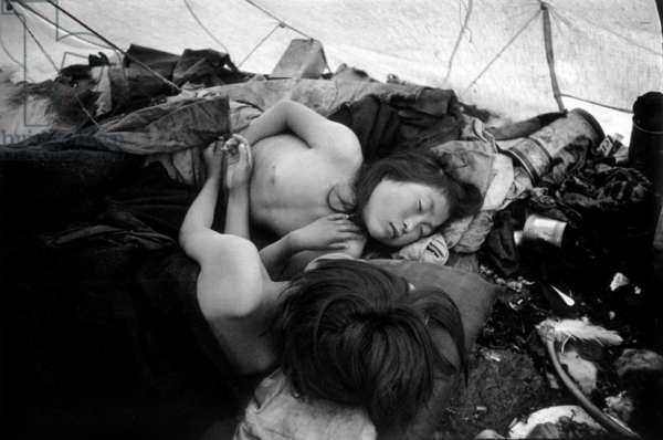 Inuit children sleeping in a tent, during polar expedition in Greenland, Kangerdlugssuatsiak, Autumn, 1936 (b/w photo)