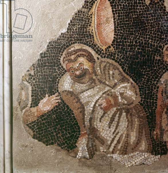 Detail from a mosaic depicting a group of masked actors preparing for a play