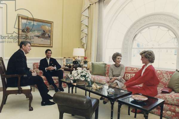 President and Nancy Reagan having tea with Prince Charles and Princess Diana in the White House Residence. Nov. 9 1985