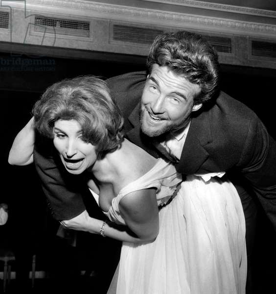 Steve Reeves Kidnapped By Actress Giselle Robert at Presentation of Film Labors of Hercules in Paris April 7, 1959 (b/w photo)