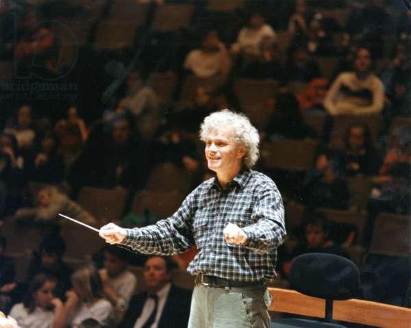Simon Rattle conducting December
