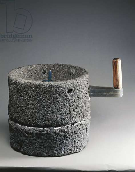 Lava cylindrical millstone used for grinding wheat, from House of the Blacksmith, Pompei
