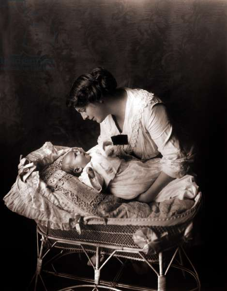 Ethel Barrymore: Ethel Barrymore (1879-1959), leaning over the crib of her third child, John Drew Colt (1913–1975) in 1913.