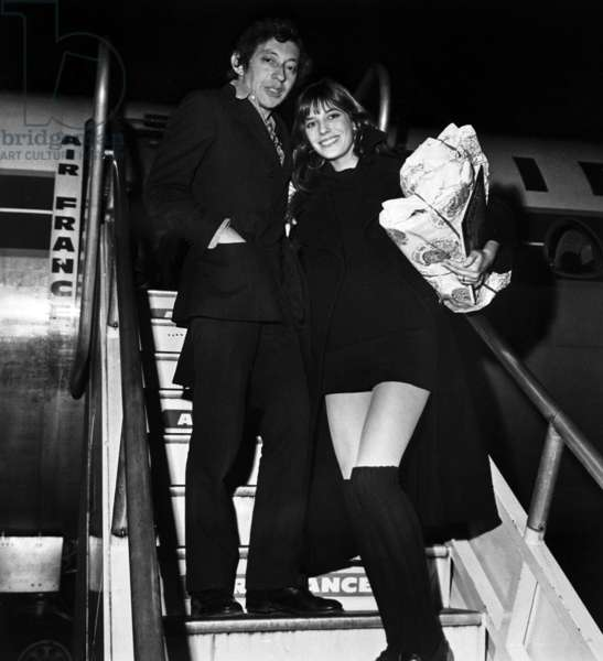 Serge Gainsbourg and Jane Birkin at Orly Airport, Paris, Befor Eleaving For London To Celebrate Christmas, December 21, 1969 (b/w photo)