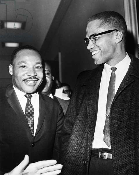 KING AND MALCOLM X, 1964 Dr. Martin Luther King Jr. (left), American cleric and civil rights leader, photographed with American religious and political leader Malcolm X at the Capitol in Washington, D.C., 26 March 1964.