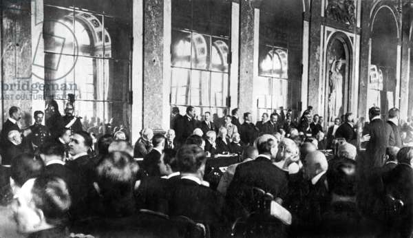 Woodrow Wilson and Georges Clemenceau signing the Treaty of Versailles, 1919 (b/w photo)