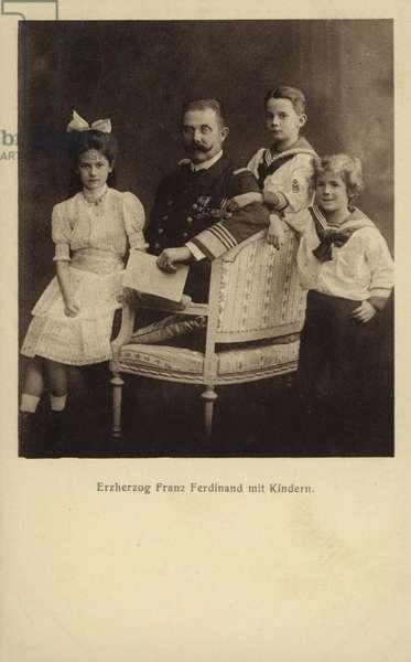 Archduke Franz Ferdinand of Austria with his children: Princess Sophie of Hohenberg; Maximilian Duke of Hohenberg; Prince Ernst of Hohenberg. (b/w photo)