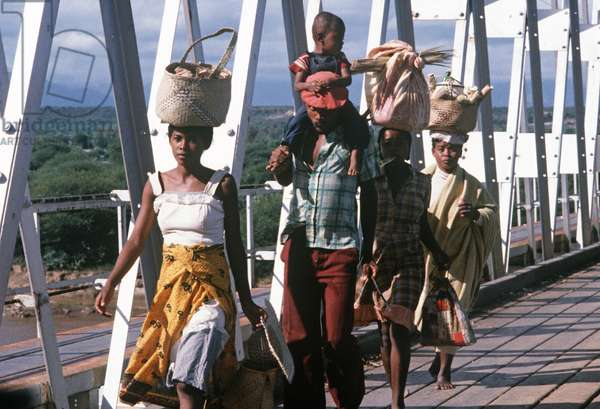 Women with baskets on heads crossing bridge in Madagascar, East Africa, Africa, 1980s (photo)