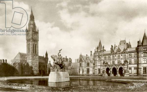 West view of Eaton Hall with the statue of Hugh Lupus in the foreground, Cheshire, UK (b/w photo)