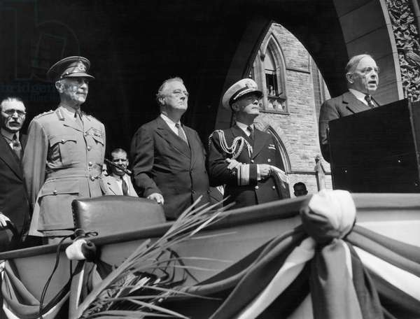 Canadian Prime Minister Mackenzie King introduces President Roosevelt to the members of the Canadian Parliament in Ottawa: The Earl of Athlone, Alexander Cambridge (front left), President Franklin D. Roosevelt (left of center), Rear Admiral Wilson Brown (second from right), Prime Minister Mackenzie King (right), August 26, 1943