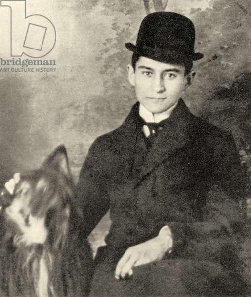 Franz Kafka with his dog, 1910 (b/w photo)