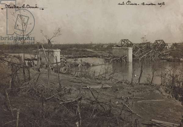 """Italo Austrian War 1915-1918"": rubble of a railway bridge over the Piave between Meste and San Donà, 18/11/1918 (b/w photo)"