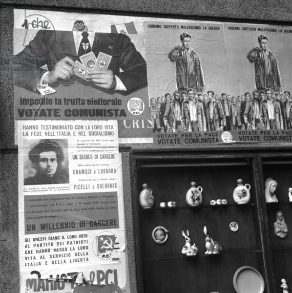Italian parliamentary elections of 1953: election posters of the Communist Party campaign with the image of Antonio Gramsci, Milan, 1953 (b/w photo)