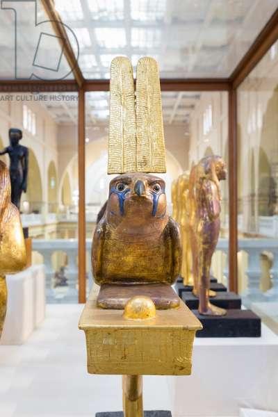 Statuette of Sopdu on standard, dynasty 18, 1336-1327 BC circa, gesso gilt wood, inlaid glass eye, copper, tomb of Tutankhamun, treasury,  Egyptian Museum, Cairo, Egypt