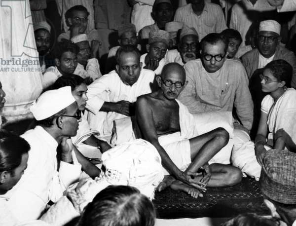 Mahatma Gandhi listens to Muslims during the height of the warfare between Muslims, Sikhs and Hindus in India. ca 1940s