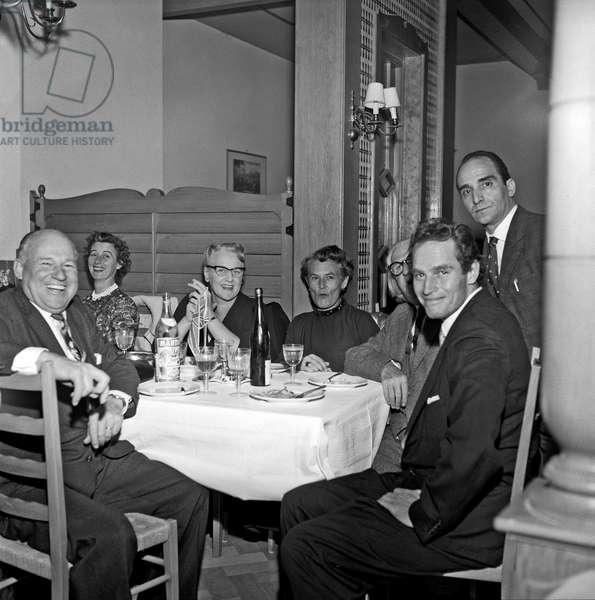 Charlton Heston sitting at the restaurant, Rome, Italy, 1959 (b/w photo)