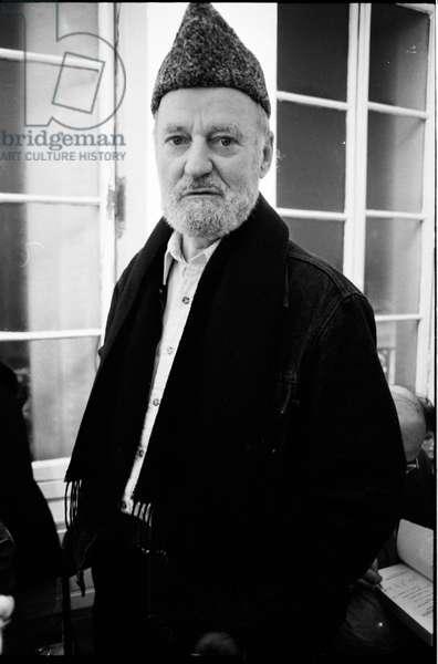 Lawrence Ferlinghetti at library Village Voice, Paris, France, 1982 (b/w photo)