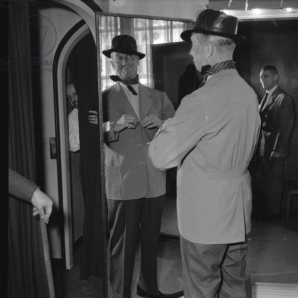 Maurice Chevalier makes fittings for the Costume for Prosper, at Larsen workshop, Paris, 1952