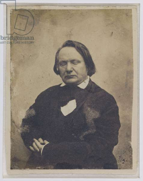 Victor Hugo with closed eyes, listening to God, 1853-55 (sepia photo)