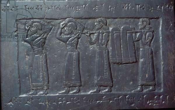 Panel depicting porters carrying the 'Marduk-Apal-Usur of Suhi', from the Black Obelisk of King Shalmaneser III, Nimrud, c.825 BC (black limestone)