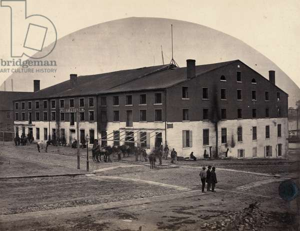 CIVIL WAR: PRISON CAMP The Confederate Libby Prison at Richmond, Virginia, taken over by Union troops during the American Civil War. Photograph, c.1865.