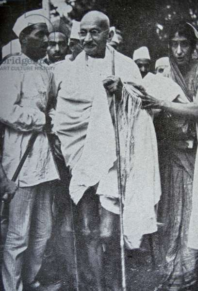 Mahatma Gandhi, Indian mystic and political leader, with some of his followers.
