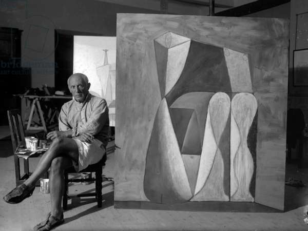 Pablo Picasso in his workshop in Antibes, France, in 1946 (b/w photo)