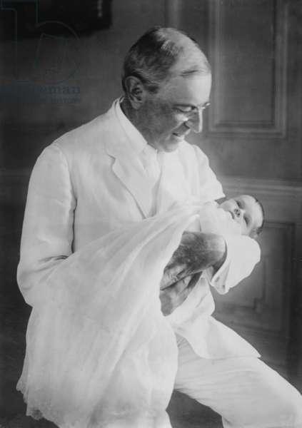 Woodrow Wilson (1856-1924) with his first grandchild, Ellen Wilson McAdoo (1915-1946)