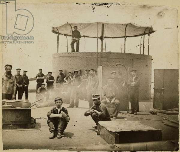 USS Monitor crew members on deck, 1862 (b/w photo)