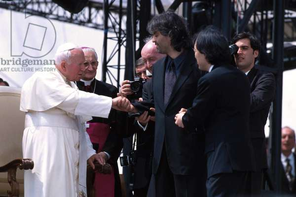 Rome, Tor Vergata, Concert of 1st May 2000. Pope John Paul II greets singer Andrea Bocelli and conductor Myung-Wun Chung (photo)
