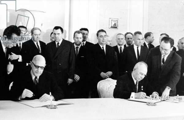 General de Gaulle and President Podgorny signing the Franco-Soviet agreement, 30 June 1966 (b/w photo)