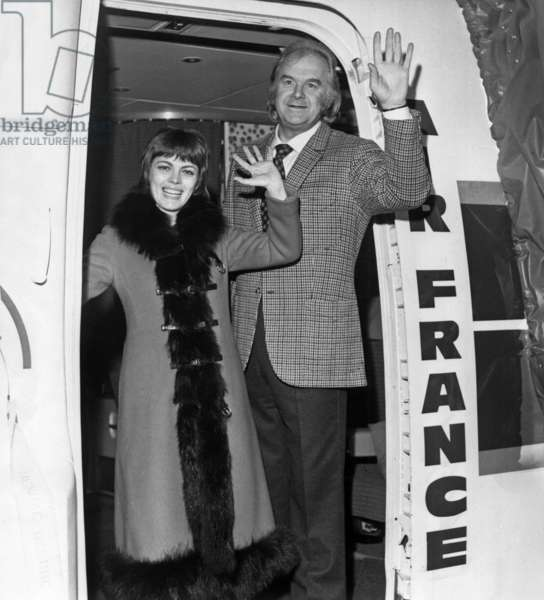 Mireille Mathieu and her Impresario Johnny Stark Aboard Plane Before Flying To Montreal Where She Is To Give Shows January 14, 1971 (b/w photo)