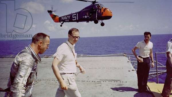 Astronaut Alan B. Shepard on the deck of the aircraft carrier, U.S.S. Lake Champlain, after the recovery of his Freedom 7 Mercury space capsule. May 5, 1961