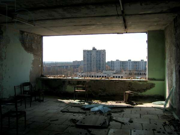 Photograph through window of building in the abandoned town of Pripyat inside the Chernobyl Exclusion Zone, 2006 (photo)