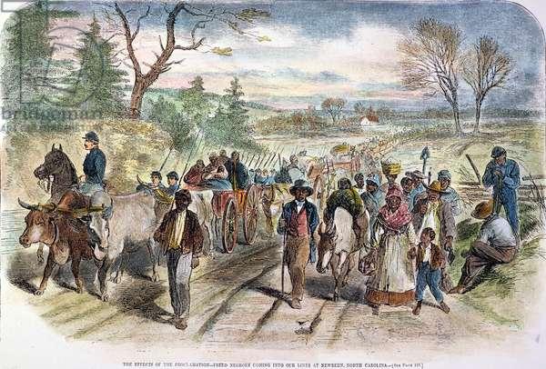 CIVIL WAR: FREEDMEN, 1863 Freed slaves coming into the Union lines at New Bern, North Carolina, following the Emancipation Proclamation. Engraving, 1863.