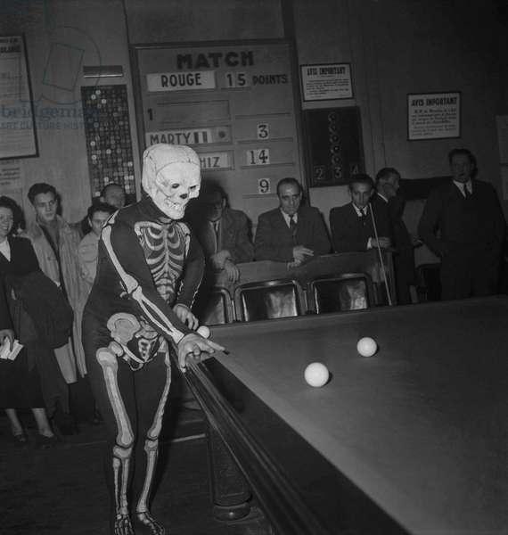 Antoine Boris, billiards player dressed as a skeleton, Paris, December 17, 1949 (b/w photo)