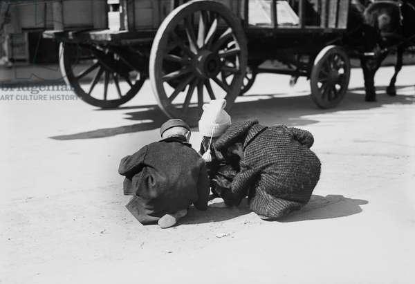 Three Children Playing in Street, New York City, New York, USA, Bain News Service, circa 1909