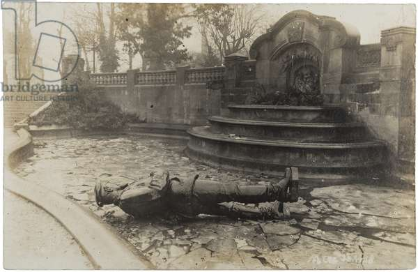 Russian photographic postcard depicting an overturned statue of Tsar Nicholas II in during the February Revolution, 1917