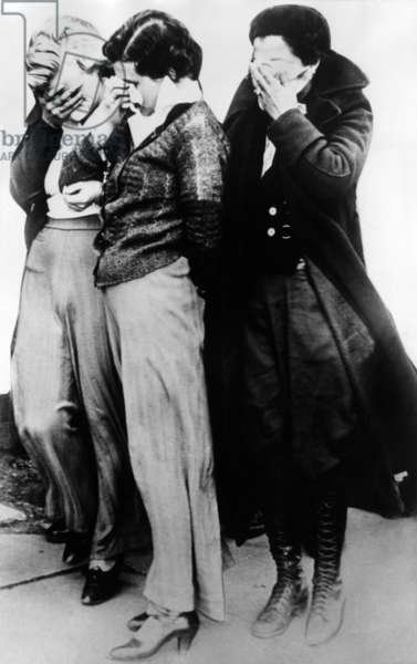 Three women who were with John Dillinger's gang at the Little Bohemia Lodge during the shoot-out the FBI agents. Two were still wearing their pajamas when they were arrested for aiding the fugitives. April 25, 1934