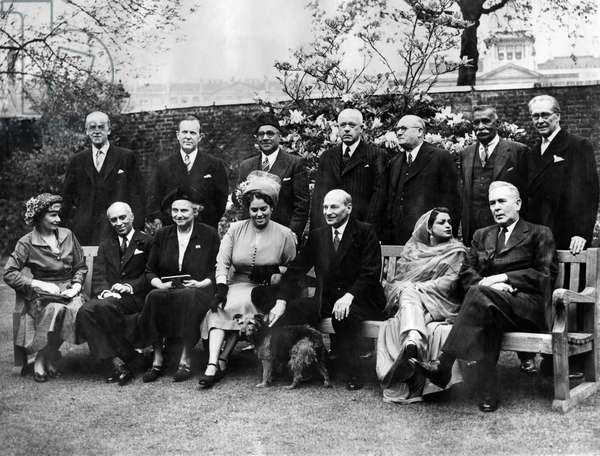 Commonwealth Conference: Left to right back row: - Sir Richard Stafford Cripps, Mr. Lester Pearson (Canada); Liaquat Ali Khan (Pakistan); Mr. Peter Fraser (New Zealand); and Dr. Malan (South Africa); Don Senayake (Ceylon); Mr. P. J. Noel Ð Baker. Left to right seated: - Mrs. Attlee; Pandit Nehru (India); Lady Cripps; Mrs. Malan; Mr. Clement Attlee; Begum Ali Khan and Mr. Joseph Chiffley (Australia).  April 1949
