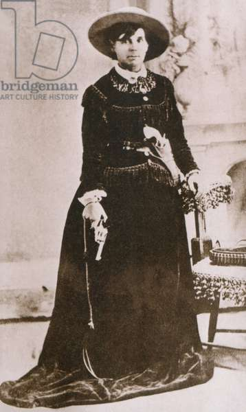 Belle Starr (1848-1889), photographed holding a revolver, was an active Western outlaw in Indian Territory (Oklahoma) the 1870s and 1880s. Gene Tierney starred in the 1941 film, BELLE STARR