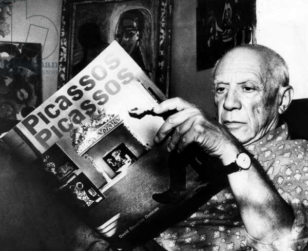 Artist Pablo Picasso reads fom his book at his home on the French Riviera. 10/19/60