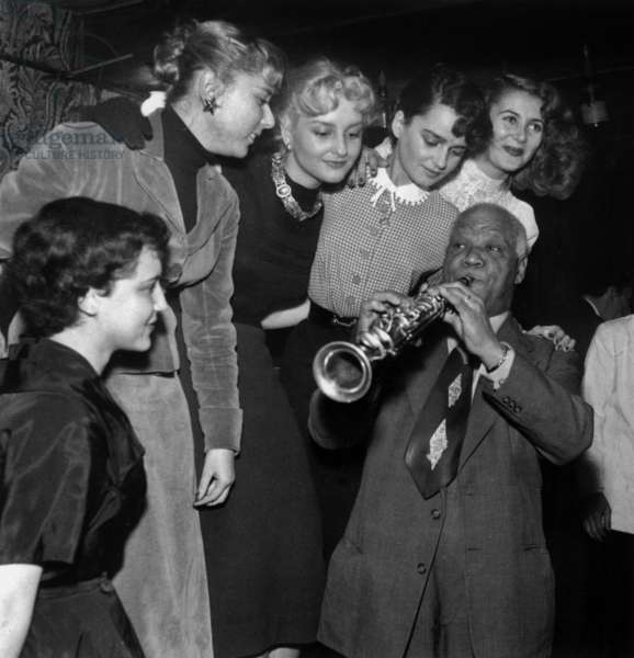 Famous Jazzman Sidney Bechet Surrounded By Starlets in Parisian Cabaret 1952 (b/w photo)