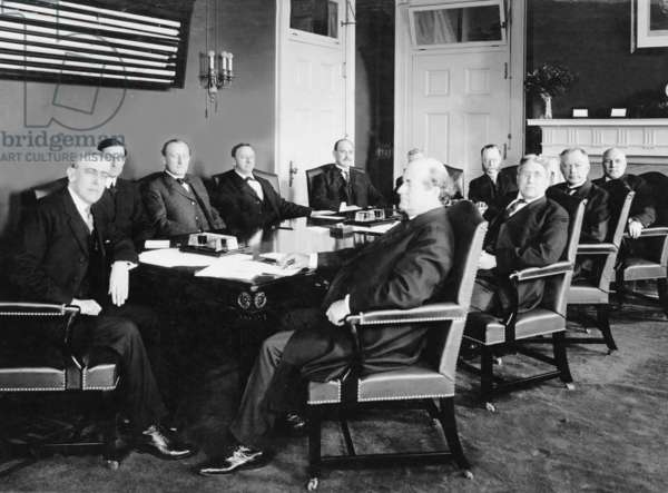 Woodrow Wilson (1856-1924) and his first Cabinet in 1913. To his immediate left is William McAdoo, Sec. of Treasury, and to his right, Williams Jennings Bryan, Sec. of State