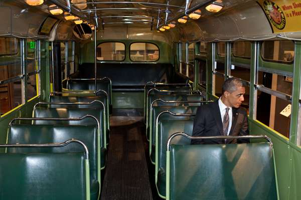 President Barack Obama sits on the famed Rosa Parks bus at the Henry Ford Museum following an event in Dearborn, Michigan, April 18, 2012. (Official White House Photo by Pete Souza)